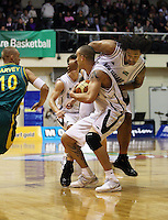 Tall Blacks guard Lindsay Tait knocks BJ Anthony aside as he looks to beat James Harvey during the International basketball match between the NZ Tall Blacks and Australian Boomers at TSB Bank Arena, Wellington, New Zealand on 25 August 2009. Photo: Dave Lintott / lintottphoto.co.nz