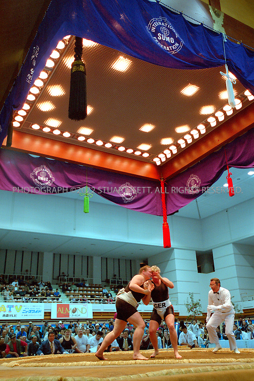 10/26/2001--Hirosaki, Aomori Prefecture, Japan..Women's sumo at the  World internationl sumo tournament...All photographs ©2003 Stuart Isett.All rights reserved.This image may not be reproduced without expressed written permission from Stuart Isett.