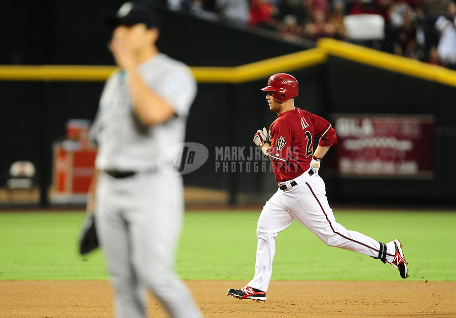 Jun. 20, 2012; Phoenix, AZ, USA; Arizona Diamondbacks infielder Aaron Hill rounds the bases after hitting a solo home run in the first inning against the Seattle Mariners at Chase Field.  Mandatory Credit: Mark J. Rebilas-