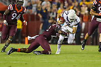 Landover, MD - September 3, 2017: West Virginia Mountaineers quarterback Will Grier (7) gets tackled by Virginia Tech Hokies safety Terrell Edmunds (22) during game between Virginia Tech and WVA at  FedEx Field in Landover, MD.  (Photo by Elliott Brown/Media Images International)