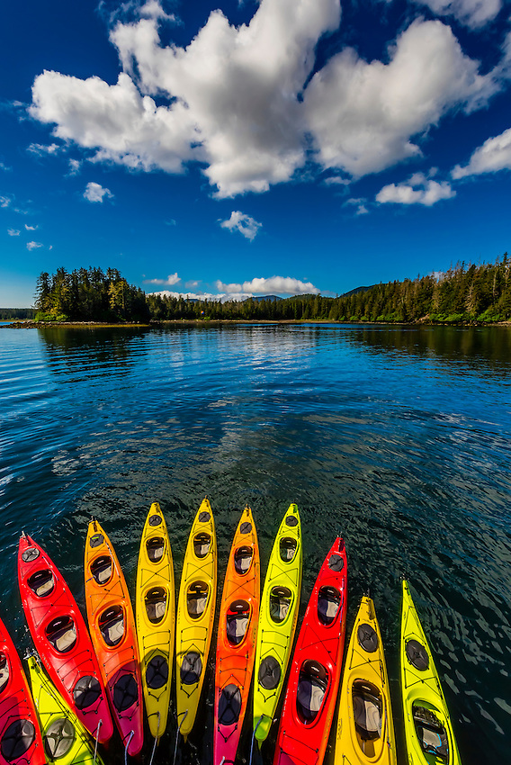 "Row of kayaks, Un-Cruise ""Wilderness Explorer"", Magoun Islands State Marine Park, Krestof Sound, Alaska USA."