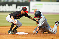 Kannapolis Intimidators shortstop Jake Brown (10) tags out Casey Kalenkosky (32) of the Rome Braves as he tries to steal second base at CMC-Northeast Stadium on June 16, 2013 in Kannapolis, North Carolina.  The Intimidators defeated the Braves 6-4.   (Brian Westerholt/Four Seam Images)