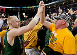 SIOUX FALLS, SD - MARCH 10: A.J. Jacobson #21 of North Dakota State gets a high five from a fan following the Bison's 57-56 victory over the South Dakota State Jackrabbits at the Summit League Championship Tournament game Tuesday at the Denny Sanford Premier Center in Sioux Falls, SD. (Photo by Dave EggenInertia)