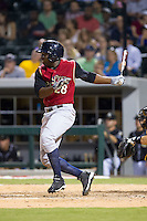 Jose Pirela (28) of the Scranton/Wilkes-Barre RailRiders follows through on his swing against the Charlotte Knights at BB&T Ballpark on July 17, 2014 in Charlotte, North Carolina.  The Knights defeated the RailRiders 9-5.  (Brian Westerholt/Four Seam Images)