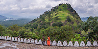 Dambulla Cave Temples, panoramic photo of two people enjoying the view, Dambulla, Central Province, Sri Lanka, Asia. This is a panoramic photo of two people enjoying the view from Dambulla Cave Temples, Dambulla, Central Province, Sri Lanka, Asia.