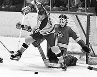 California Golden Seals Gary Jarrett in front of Pittsburg Penguins goalie Al Smith (1971 photo/Ron Riesterer)