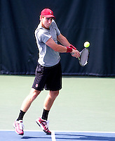 STANFORD, CA -- April 11, 2014: John Morrissey, during Stanford vs Washington on Friday afternoon at Taube Family Tennis Stadium.