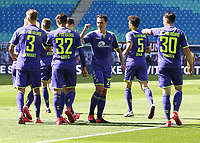 16th May 2020, Red Bull Arena, Leipzig, Germany; Bundesliga football, Leipzig versus FC Freiburg; Scorer Manuel Gulde celebrates with team mates for his goal for 0-1 in the 34th minute