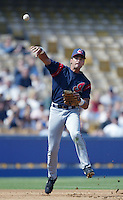 Omar Vizquel of the Cleveland Indians throws to first base during a 2002 MLB season game against the Los Angeles Dodgers at Dodger Stadium, in Los Angeles, California. (Larry Goren/Four Seam Images)