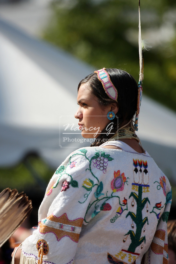 A female Native American Indian dancer at a Pow Wow at the Milwaukee Lakefront Indian Summer Festival, Wisconsin
