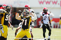 July 10, 2010; Hamilton, ON, CAN; Hamilton Tiger-Cats defensive end Garrett McIntyre (71) celebrates his sack of Calgary Stampeders quarterback Henry Burris (1). CFL football: Calgary Stampeders vs. Hamilton Tiger-Cats at Ivor Wynne Stadium. The Tiger-Cats lost against the Stampeders 23-22. Mandatory Credit: Ron Scheffler. Copyright (c) 2010 Ron Scheffler.