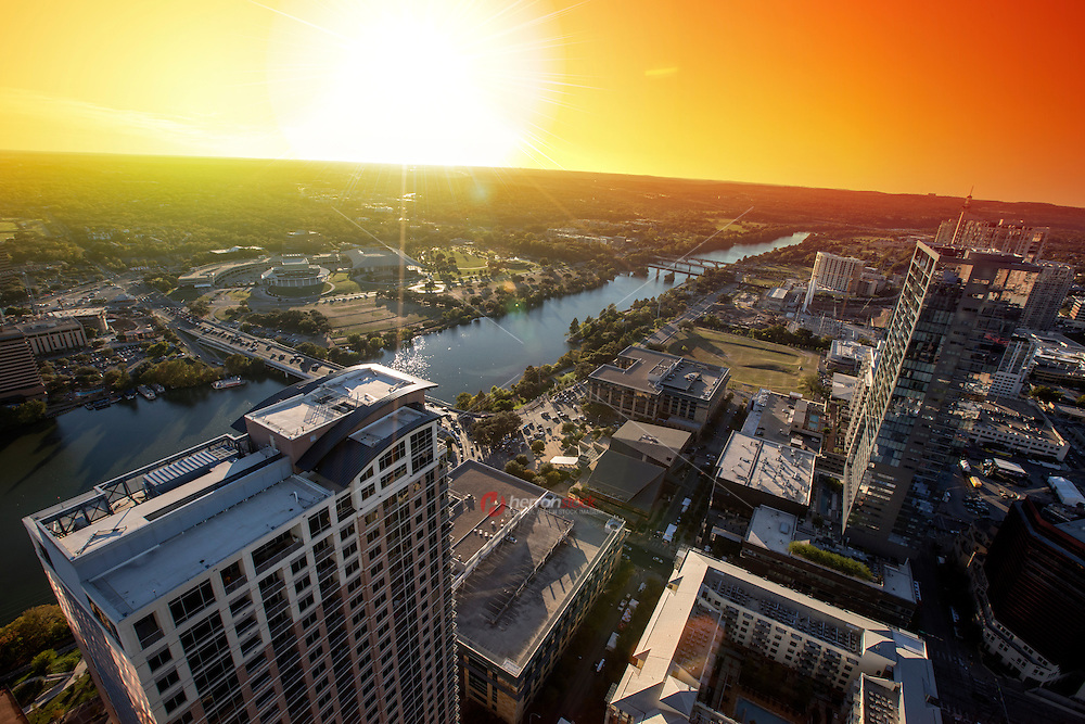 Beautiful sunset falls on Lady Bird Lake from high atop the Austin Skyline looking far off to west Austin.