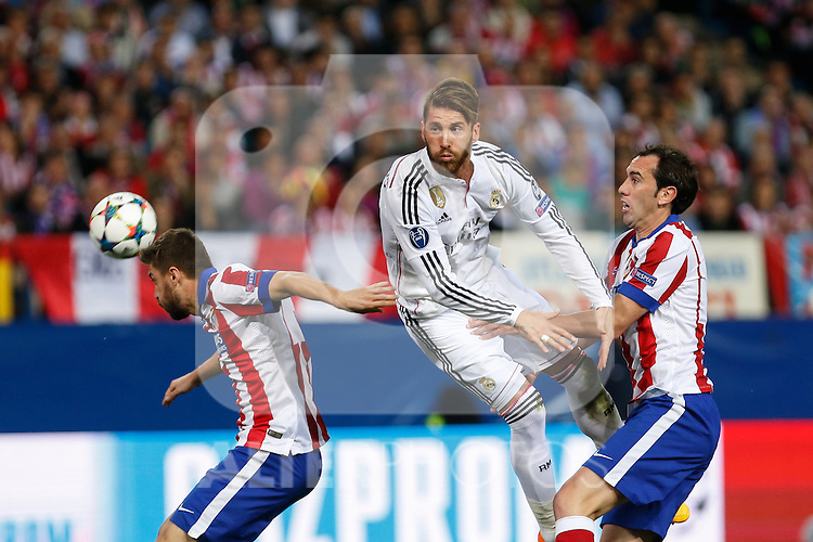 Atletico de Madrid's Siqueira and Juanfran and Real Madrid´s Sergio Ramos during quarterfinal first leg Champions League soccer match at Vicente Calderon stadium in Madrid, Spain. April 14, 2015. (ALTERPHOTOS/Victor Blanco)