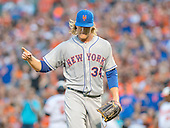 New York Mets starting pitcher Noah Syndergaard (34) celebrates after working himself out of a bases-loaded no-out jam in the first inning against the Baltimore Orioles at Oriole Park at Camden Yards in Baltimore, Maryland on Wednesday, August 19, 2015.  The Orioles won the game 5 - 4.<br /> Credit: Ron Sachs / CNP<br /> (RESTRICTION: NO New York or New Jersey Newspapers or newspapers within a 75 mile radius of New York City)