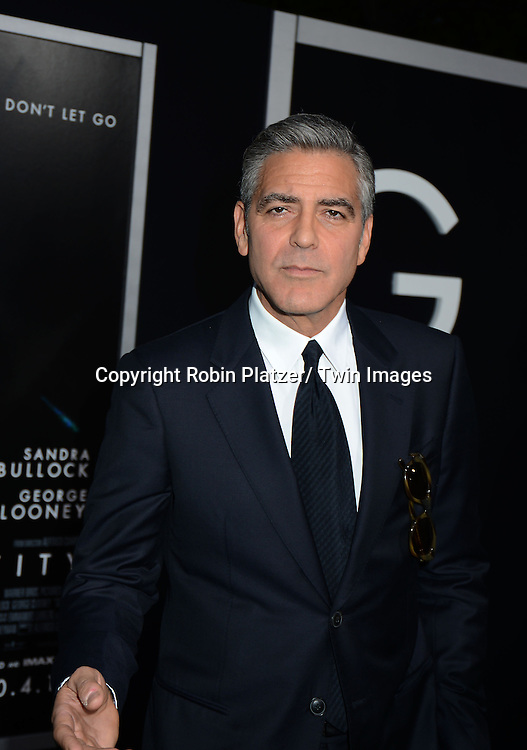 "George Clooney attends the New York Premiere of "" Gravity"" on October 1, 2013 at the AMC Lincoln Square Theatre in New York City."
