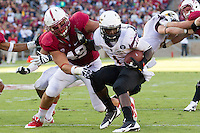 Stanford, CA -- September 21, 2013:  Stanford's Ben Gardner makes a tackle during a game against Arizona State at Stanford Stadium. Stanford defeated the Sun Devils 42 - 28.