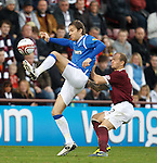 Sasa Papac blooters the ball past Jamie Hamill on the wing