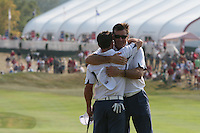 Paul Casey hugs Nick Faldo after halving the hole on the 18th during the final round of Single Matches at The 37th Ryder cup from Valhalla Golf Club in Louisville, Kentucky....Photo: Fran Caffrey/www.golffile.ie.