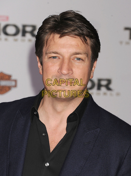 HOLLYWOOD, CA - NOVEMBER 04: Nathan Fillion at the Los Angeles Premiere 'Thor: The Dark World' at the El Capitan Theatre on November 4, 2013 in Hollywood, California, USA.<br /> CAP/ROT/TM<br /> &copy;Tony Michaels/Roth Stock/Capital Pictures