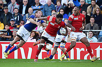 Jack Ram of Tonga takes on the Namibia defence. Rugby World Cup Pool C match between Tonga and Namibia on September 29, 2015 at Sandy Park in Exeter, England. Photo by: Patrick Khachfe / Onside Images