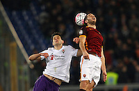 Calcio, Serie A: Roma vs Fiorentina. Roma, stadio Olimpico, 4 marzo 2016.<br /> Fiorentina&rsquo;s Nikola Kalinic, left, and Roma&rsquo;s Kostas Manolas jump for the ball during the Italian Serie A football match between Roma and Fiorentina at Rome's Olympic stadium, 4 March 2016.<br /> UPDATE IMAGES PRESS/Riccardo De Luca