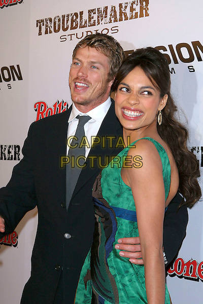 "JASON LEWIS & ROSARIO DAWSON.""Sin City"" World Premiere held at Mann National Theater, Westwood, Los Angeles, California, USA, .March 28th 2005..half length couple arm around waist.Ref: ADM.www.capitalpictures.com.sales@capitalpictures.com.©Jacqui Wong/AdMedia/Capital Pictures."
