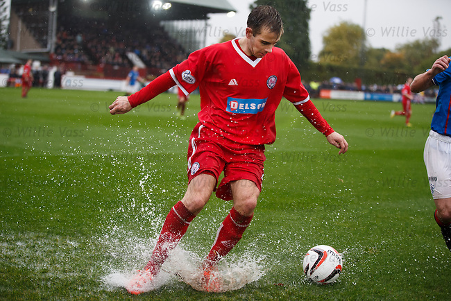 Alan Trouten splashing about on the rain lashed park
