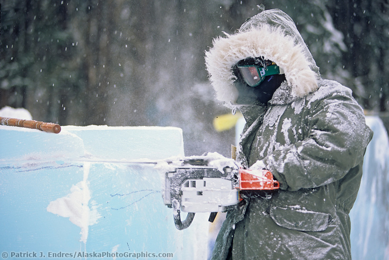 Ice carver uses a chain saw to shape blocks of ice during the World Ice Art Championships held each march in Fairbanks.