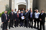 Palestinian Prime Minister Salam Fayyad, receives the annual report of the financial and administrative control, in the West Bank city of Ramallah, on May 8, 2013. Photo by Mustafa Abu Dayeh