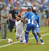 Kenny Cunningham (8) of Costa Rica goes against Juan Carlos Garcia (6) of Honduras.  Honduras defeated Costa Rica 1-0 at the quaterfinal game of the Concacaf Gold Cup, M&T Stadium, Sunday July 21 , 2013.