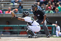 Lynchburg Hillcats catcher Juan De La Cruz (44) sets a target as home plate umpire Erich Bacchus looks on during the game against the Frederick Keys at Calvin Falwell Field at Lynchburg City Stadium on May 14, 2015 in Lynchburg, Virginia.  The Hillcats defeated the Keys 6-3.  (Brian Westerholt/Four Seam Images)