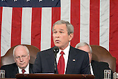 United States President George W. Bush delivers his State of the Union Address to a Joint Session of Congress in the Capitol in Washington, D.C. on February 2, 2005.  United States Vice President Dick Cheney, left, and the Speaker of the United States House of Representatives J. Dennis Hastert (Republican from the 14th District of Illinois), right, listen from behind.<br /> Credit: Luke Frazza / Pool via CNP