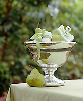 Detail of a silvered vase filled with pears and small presents tied with green ribbon