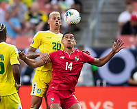 CLEVELAND, OH - JUNE 22: Matthew Briggs #20 and Valentin Pimentel #14 head the ball during a game between Panama and Guyana at FirstEnergy Stadium on June 22, 2019 in Cleveland, Ohio.