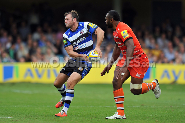 Luke Arscott looks to pass the ball. Aviva Premiership match, between Bath Rugby and Leicester Tigers on September 20, 2014 at the Recreation Ground in Bath, England. Photo by: Patrick Khachfe / Onside Images