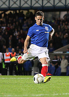 Ian Black scores under pressure in the Rangers v Queen of the South Quarter Final match in the Ramsdens Cup played at Ibrox Stadium, Glasgow on 18.9.12.