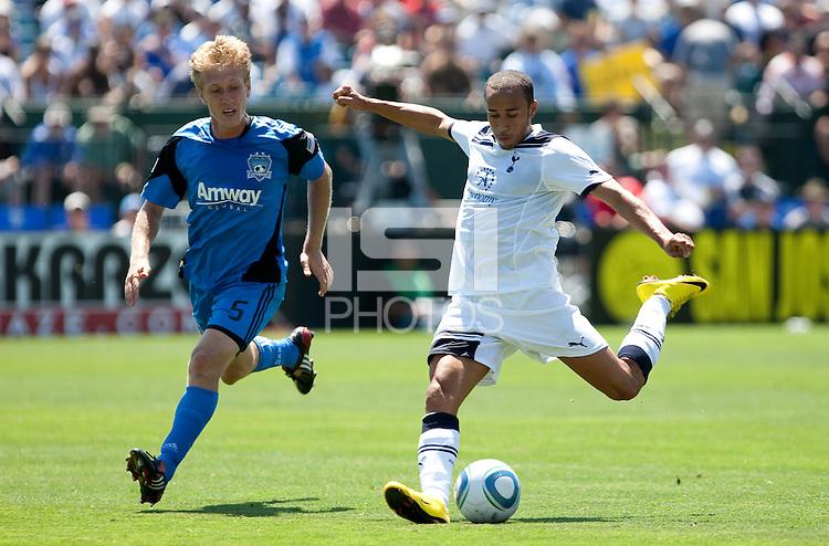 Andros Townsend (right) kicks the ball ahead of Brad Ring (left). San Jose Earthquakes tied  Tottenham Hotspur 0-0 at Buck Shaw Stadium in Santa Clara, California on July 17th, 2010.