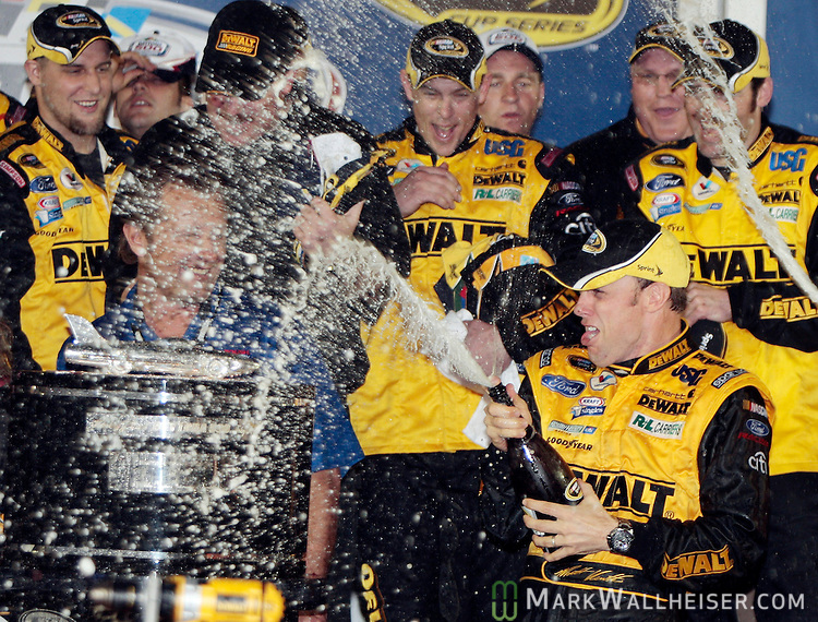 Matt Kenseth sprays teammates with champagne in Gatorade Victory Lane to celebrate his winning the rain-shortened 51st Daytona 500 NASCAR Sprint Cup Series race at the Daytona International Speedway in Daytona Beach, Florida February 15, 2009.  (Mark Wallheiser/TallahasseeStock.com)