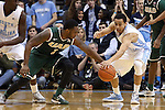 27 December 2014: North Carolina's Marcus Paige (right) knocks the ball away from UAB's Denzell Watts (1). The University of North Carolina Tar Heels played the University of Alabama Birmingham Blazers in an NCAA Division I Men's basketball game at the Dean E. Smith Center in Chapel Hill, North Carolina. UNC won the game 89-58.