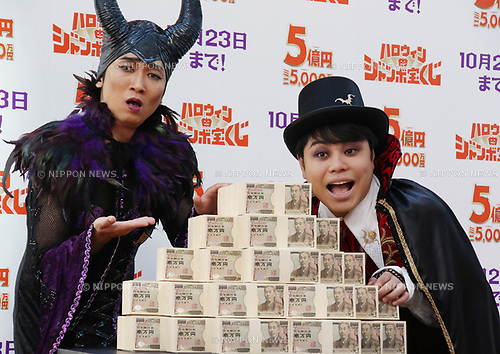 """October 1, 2018, Tokyo, Japan - Japan's comedy duo NON STYLE members Akira Ishida (L) and Yusuke Inoue in costumes of a witch and Dracura attend a promotional event of """"Halloween Jumbo Lottery"""" as the first tickets go on sale in Tokyo on Monday, October 1, 2018.   (Photo by Yoshio Tsunoda/AFLO) LWX -ytd-"""