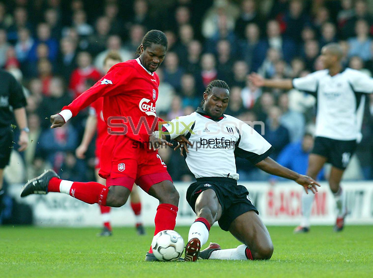 Pix: Rob Matthews/SWpix.com. Soccer. Barclaycard Premiership. Season 2002/2003. Fulham v Liverpool. 23/11/2002...COPYWRIGHT PICTURE>>SIMON WILKINSON>>01943 436649>>..Salif Diao tries to offload the ball before being tackled by Martin Djetou..