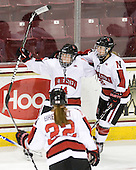 Casey Pickett (NU - 14), Dani Rylan (NU - 2) - The Harvard University Crimson defeated the Northeastern University Huskies 4-3 (SO) in the opening round of the Beanpot on Tuesday, February 8, 2011, at Conte Forum in Chestnut Hill, Massachusetts.