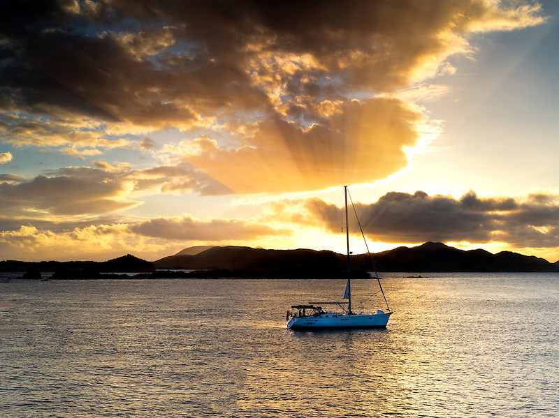 Boat off St. John, Virgin Islands and sunset.