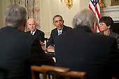"""United States President Barack Obama, center, speaks while meeting with members of the Democratic Governors Association in the State Dining Room of the White House with U.S. Vice President Joseph """"Joe"""" Biden, left, and Valerie Jarrett, senior advisor to Obama, in Washington, D.C., U.S., on Friday, Feb. 21, 2014. Obama will emphasize Democratic priorities in his next budget, dropping an offer to trim the growth of entitlement spending and proposing new tax limits for U.S.-based multi-national companies. <br /> Credit: Andrew Harrer / Pool via CNP"""