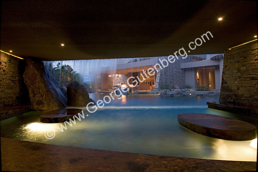View at night from bar in underwater cave in luxury swimming pool