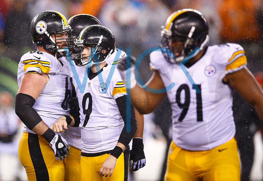 Chris Boswell #9 of the Pittsburgh Steelers is congratulated by teammate David DeCastro #66 after kicking the game-winning field goal against the Cincinnati Bengals in the fourth quarter during the Wild Card playoff game at Paul Brown Stadium on January 9, 2016 in Cincinnati, Ohio. (Photo by Jared Wickerham/DKPittsburghSports)