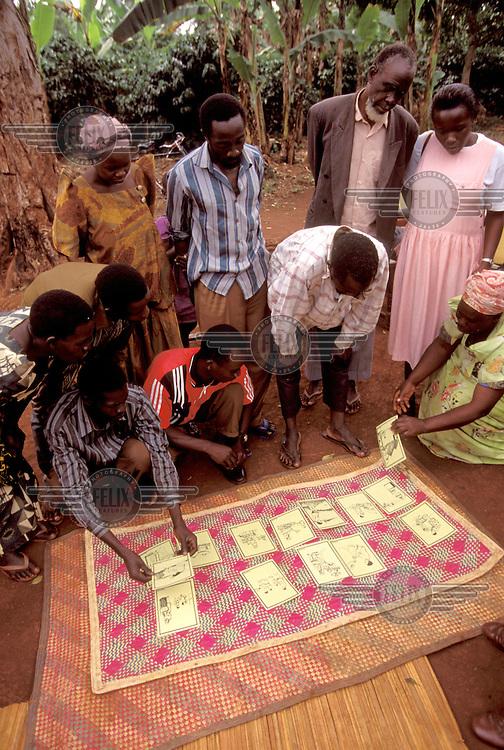 © Caroline Penn / Panos Pictures..Near Mukono, UGANDA. 07/1999..Villagers in Nakalanga at a hygiene education session organised by the British NGO WaterAid.