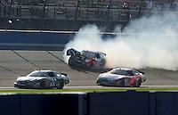 Oct. 10, 2009; Fontana, CA, USA; NASCAR Nationwide Series drivers Joey Logano (20) and David Ragan (6) go low to avoid Denny Hamlin (18) as he crashes during the Copart 300 at Auto Club Speedway. Mandatory Credit: Mark J. Rebilas-