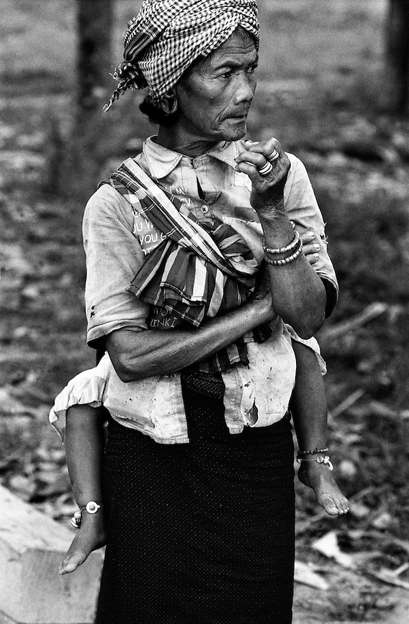 "Mekong Dam Victims - Cambodia. A woman from one of the relocated villages uphill from the river. At least 55.000 people living near the Sesan river in Cambodia's Ratanakiri and Stung Treng provinces continue to suffer due to lost rice production, lost fishing income, drowned livestock and damaged vegetable gardens, and so also great economical losses, because of the unpredictable floodings from the Yali Falls Dam on the other side of the border in Vietnam. To this day, flash floodings have caused the deaths of at least 39 villagers from various ethnic minority groups living along the river. Despite this, four other major hydropower projects are now in operation or under construction on the Sesan River in Vietnam. Known as ""The Mother of Waters"", more than 60 million people depend on the Mekong river and its tributaries for food, fresh water, transport and other aspects of daily life. The construction of big dams is now threatening the life of these people aswell as the vital and unique ecosystem of the river."