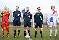 20140209 - TUBIZE , BELGIUM : Belgian Captain Elke Van Gorp (l) pictured with assistant referee Stephanie Forde , referee Lois Otte , assistant X and Dutch Captain Jill Roord (r) during a friendly soccer match between the Under 19 ( U19) women teams of Belgium and The Netherlands , Sunday 9 February 2014 in Tubize . PHOTO DAVID CATRY